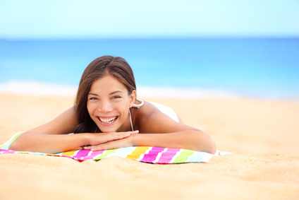 Beach summer woman sunbathing enjoying sun smiling